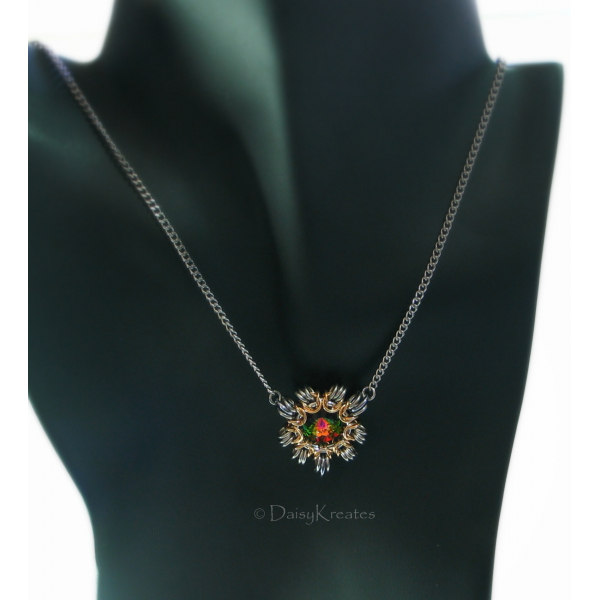 Sun burst motif with steampunk flair, sits front center under collarbone