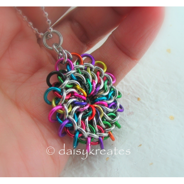 Chainmaille Mandala Pendant's colors reminiscent of Tibetan sand mandala