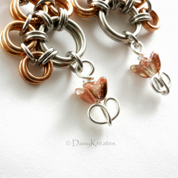Bronze foiled glass tulip beads dots the end of each earrings, adds movements