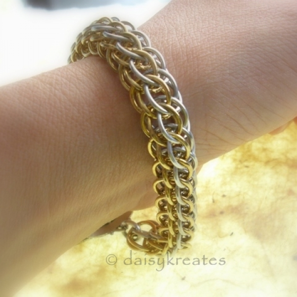 """The bracelet measures 7 1/2"""" long, 1/2"""" wide, weighs less than 1 oz."""