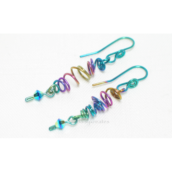 Freehand forming of the earrings ensures the organic look and feel of the sprite