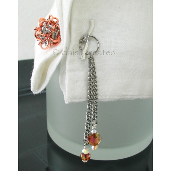 Unique design of cufflink with tassels offers feminine flair