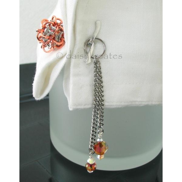 Unique design of cufflink with tassels offers feminine flair