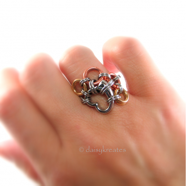 Paw Print motif wears on an asymmetrical hug on the finger