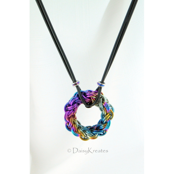 Circular chainmaille pendant in kinged/doubled Vipera Berus weave