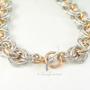 Necklace closes with gold tone toggle ring and silver tone Wave toggle bar