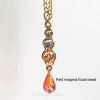 Golden Harvest Y necklace with red magma focal drop bead