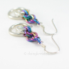 Beautiful Tea Rose earrings with soft glow of silver and colorful rainbow