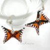 Mimicking nature, no two Monarch butterfly earrings are exactly the same