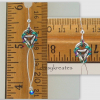 Each Nox earring measures 2 1/4 inches long, 1/2 inch wide