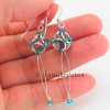 These pretty earrings are made of sterling silver, natural titanium, anodized ni