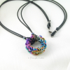 Pure niobium pendant anodized to include all spectrum of colors