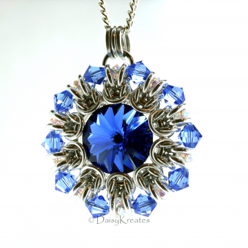 Sunburst medallion pendant with blue Swarovski rivoli and crystals beads
