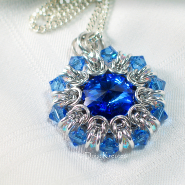 Clear and blue bicone beads form pointy outer rim as crystal ruffle