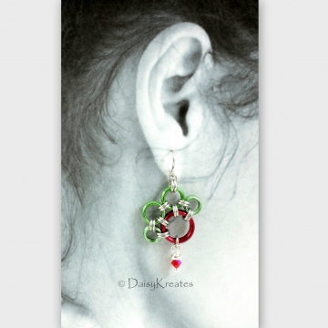 "Rudolf's PawPrints earrings measures 1"" wide, bit over 1.5"" long"