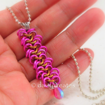 Hot pink anodized aluminum rings perfectly matched with the pink drop bead